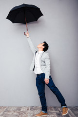 Young man holding umbrella