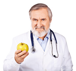Smiling doctor offering a green apple