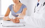 patient and doctor prescribing medication