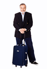 Portrait of an old man standing with luggage bag
