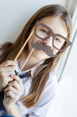 Portrait of a schoolgirl in funny glasses