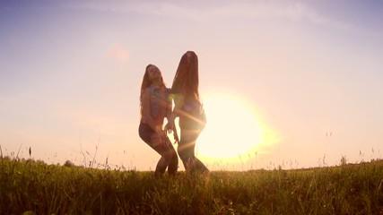 Beauty teen girls having fun outdoors. Slow motion