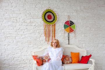 Woman sitting on white sofa