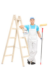 Male house painter holding a paint roller