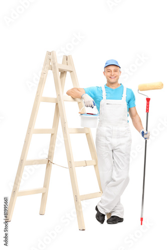 Male house painter holding a paint roller - 81995661
