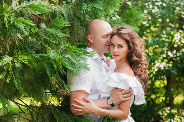 Sensual portrait of a beautiful couple are kissing and hugging