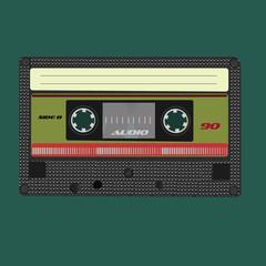 Audio cassete. Vector illustration. Isolated on green background