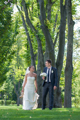 Just married couple walking in the woods