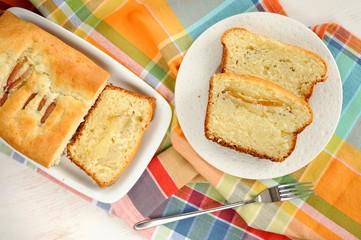 Mascarpone cake slice, long fork on white bright background top