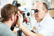 Постер, плакат: Ophthalmologist or optometrist optician at work