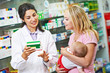 Pharmacy chemist, mother and child in drugstore