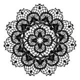 Black crochet doily.
