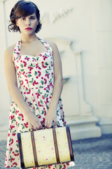 Retro woman with antique suitcase