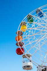 Detail of a colorful ferris wheel seen on a fair