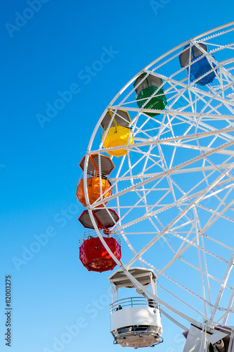 canvas print picture Detail of a colorful ferris wheel seen on a fair