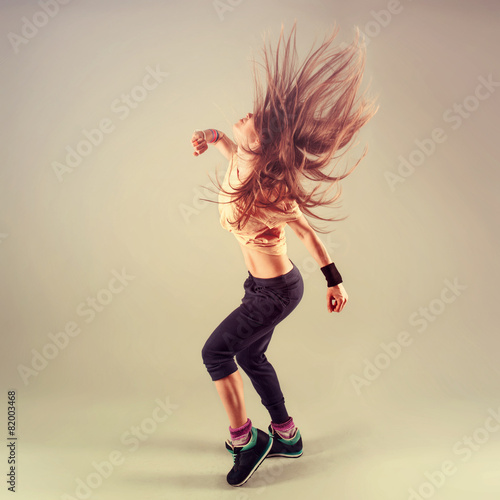 Poster Studio shoot of active female funk jazz dancer moving.