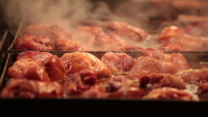 Appetizing slices of meat are fried on a big baking sheet