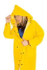 serious woman in yellow raincoat looking