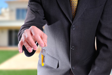 Half body commercial agent with keys in hand