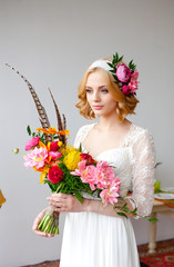 bride with bright bouquet and flowers in her hair