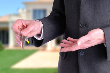Half lateral body commercial agent with keys in hand
