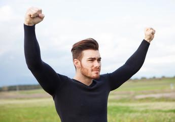 Winner strong man in the meadow