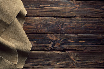 Canvas bag on old wooden planks