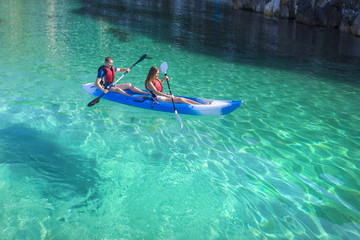 Kayaking. Young happy couple traveling by kayak.