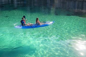 Kayaking. Young happy couple traveling kayak Activities on water