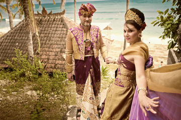 Vintage image of mature couple dressed in Balinese costume