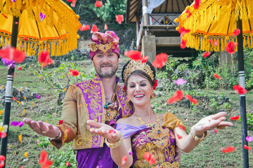 mature couple dressed in Balinese costume