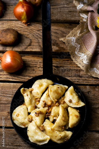 Potatoes vareniki in a ceramic bowl.