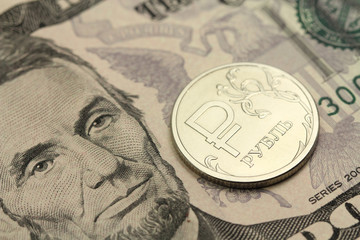 Russian ruble against the backdrop of five US dollars background