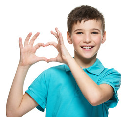 Portrait of happy  teen boy with a heart shape
