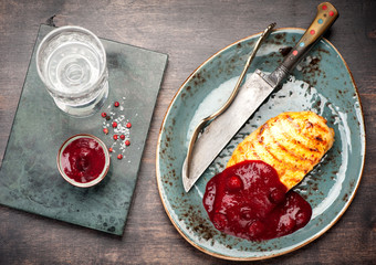 Grilled chicken breast and cranberry sauce. top view