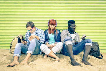 Group of young multiracial friends with smartphone outdoors