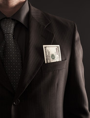 Businessman with one hundred dollars