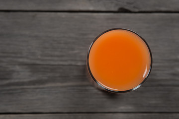 Carrot juice in glass. View from top