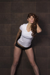 Young athletic womal in lingerie at studio