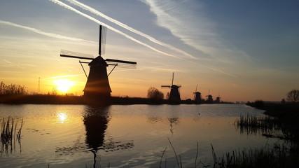 Silhouette windmills in Kinderdijk Netherlands