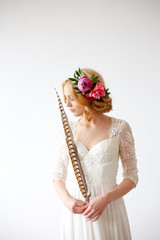 Beautiful bride posing with long feather