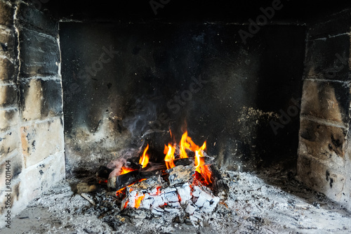 Leinwanddruck Bild Feuer im Kamin