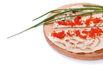 pancakes with caviar on white, close-up