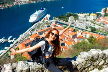 Woman traveling in old city Kotor, Montenegro
