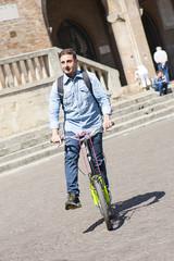Schoolboy on footbike
