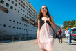 Woman tourist near the big cruise liner - 82012231