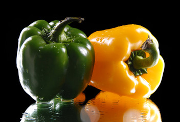 green and yellow sweet pepper  on a black background