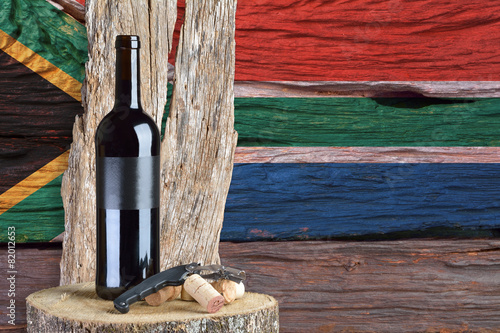 bottle of wine with South Africa flag in the background - 82012653