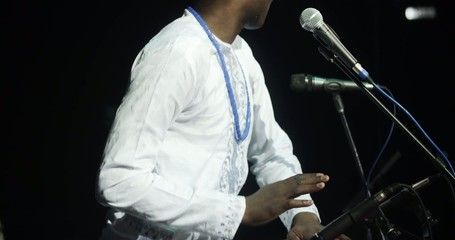 African man singing and playing ethnic drums 12
