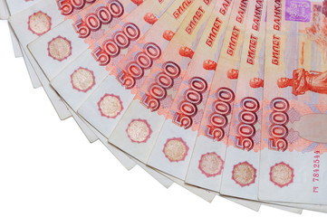 Banknotes of 5000 Russian rubles are located around.